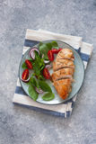 Baked chicken breast and fresh basil and tomatoes salad Royalty Free Stock Photos