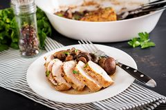 Baked chicken breast with mushrooms in balsamic sauce. On the table stock photo