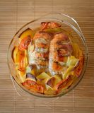 Baked chicken breast with potatoes, top view. royalty free stock images