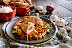 Baked chicken breast stuffed with cheese, tomato and basil with rice and steamed vegetable salad. Baked chicken breast stuffed with Feta cheese, sun dried tomato Royalty Free Stock Photo