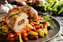 Baked chicken breast stuffed with cheese, tomato and basil with rice and steamed vegetable salad Royalty Free Stock Photography