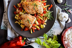 Baked chicken breast stuffed with cheese, tomato and basil with rice and steamed vegetable salad Stock Photography