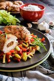 Baked chicken breast stuffed with cheese, tomato and basil with rice and steamed vegetable salad Stock Image