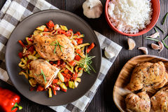 Baked chicken breast stuffed with cheese, tomato and basil with rice and steamed vegetable salad Royalty Free Stock Photo