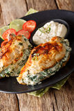 Baked chicken breasts with cheese and spinach filling with sauce Royalty Free Stock Photo