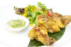 Baked chicken in curry sauce Stock Image