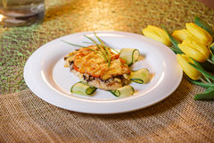 Baked chicken cutlet with cheese and mushrooms Stock Image
