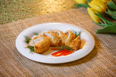 Baked chicken cutlet with cheese and mushrooms Stock Photos