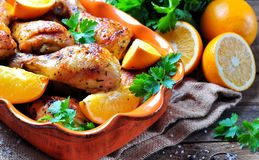 Baked chicken drumstick with orange, smoked paprika, Provencal herbs and olive oil. royalty free stock images