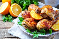 Baked chicken drumstick with orange, smoked paprika, Provencal herbs and olive oil. Stock Photos