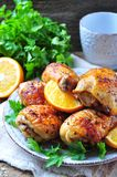 Baked chicken drumstick with orange, smoked paprika, Provencal herbs and olive oil. Royalty Free Stock Photography