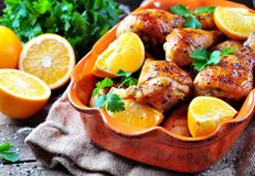 Baked chicken drumstick with orange, smoked paprika, Provencal herbs and olive oil. Stock Images