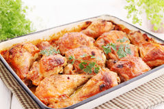 Baked chicken drumsticks Stock Photos