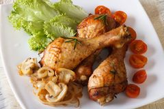 Baked chicken drumsticks with mushrooms horizontal top view Stock Photography