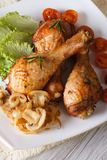 Baked chicken drumsticks with mushrooms vertical top view Stock Photo