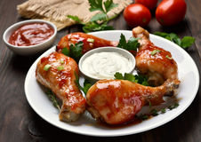 Baked chicken drumsticks Stock Photos