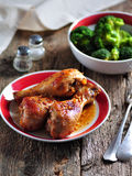 Baked chicken drumsticks with soy sauce, honey and grain mustard with boiled broccoli. Royalty Free Stock Photo