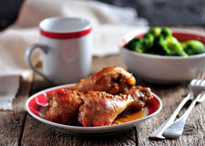 Baked chicken drumsticks with soy sauce, honey and grain mustard with boiled broccoli. Royalty Free Stock Photos