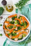 Baked chicken filet with a broccoli and pumpkin with spicy herb. Stock Photos