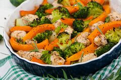 Baked chicken filet with a broccoli and pumpkin with spicy herb Stock Photos