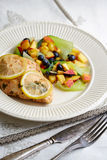 Baked chicken fillet with fruit garnish Royalty Free Stock Photography
