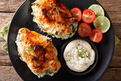 Baked Chicken fillet stuffed with cheese and spinach with sauce Stock Image