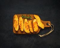 Baked Chicken Fingers. Top View of Baked Chicken Fingers Nuggets on Dark Background Stock Image