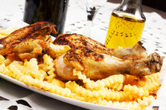 Baked chicken with french fries Royalty Free Stock Photo