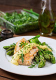Baked chicken garnished with asparagus Stock Images