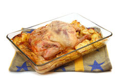 Baked chicken in a glass dish. On a white background Royalty Free Stock Photography