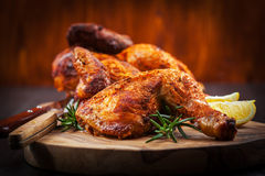 Baked chicken with herbs stock images
