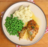 Baked Chicken Kiev Breast with Vegetables Meal Stock Images