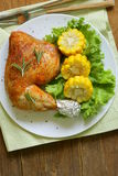 Baked chicken leg with corn Royalty Free Stock Photos