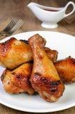 Baked chicken leg stock images