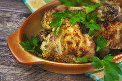 Baked Chicken legs board table wooden meat food roast grilled Stock Photography