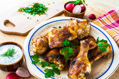 Baked Chicken legs board table wooden meat food roast grilled Stock Photo