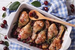 Baked chicken legs in cherry sauce in a dish horizontal top view Stock Images