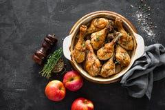 Baked chicken legs on dark background. top view. Baked chicken legs. top view stock image