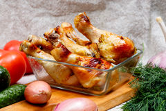 Baked chicken legs are in the glass box, BBQ facilities Stock Photo