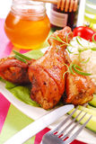 Baked chicken legs with honey royalty free stock photo