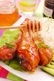 Baked chicken legs with honey Stock Photos