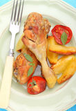 Baked chicken legs with potatoes Royalty Free Stock Photo