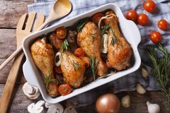 Baked chicken legs with vegetables close-up horizontal top view Stock Photos