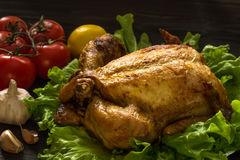 Baked chicken on lettuce leaves Stock Photography