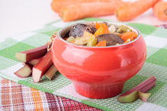 Baked chicken liver, rhubarb and carrots Stock Image