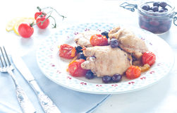 Baked chicken with olives and cherry tomatoes Royalty Free Stock Photo