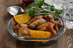 Baked chicken with orange, garlic and onion Royalty Free Stock Photo