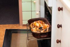 Baked chicken in oven Royalty Free Stock Image