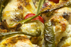 Baked chicken with peppers and tomatoes. Close up Royalty Free Stock Image