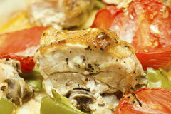 Baked chicken with peppers and tomatoes. Close up Stock Photography